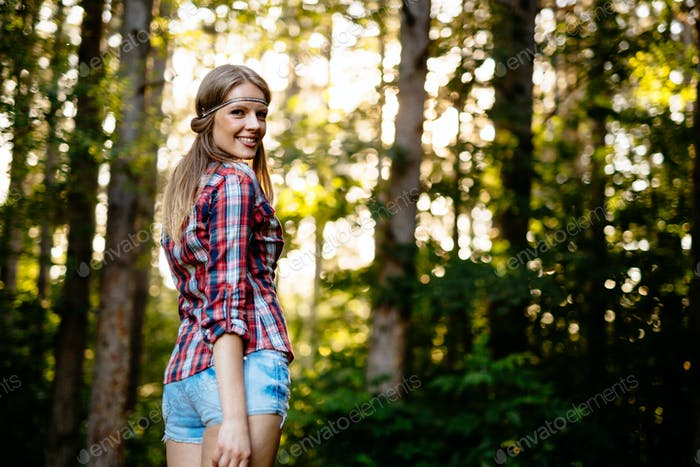 Smiling beautiful woman in forest