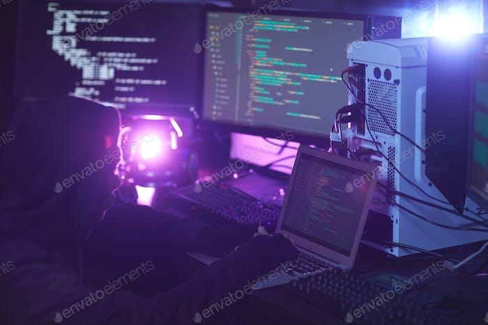 Computer Hacker Coding in Dark