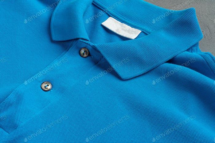 Blue cotton polo t-shirt texture close up