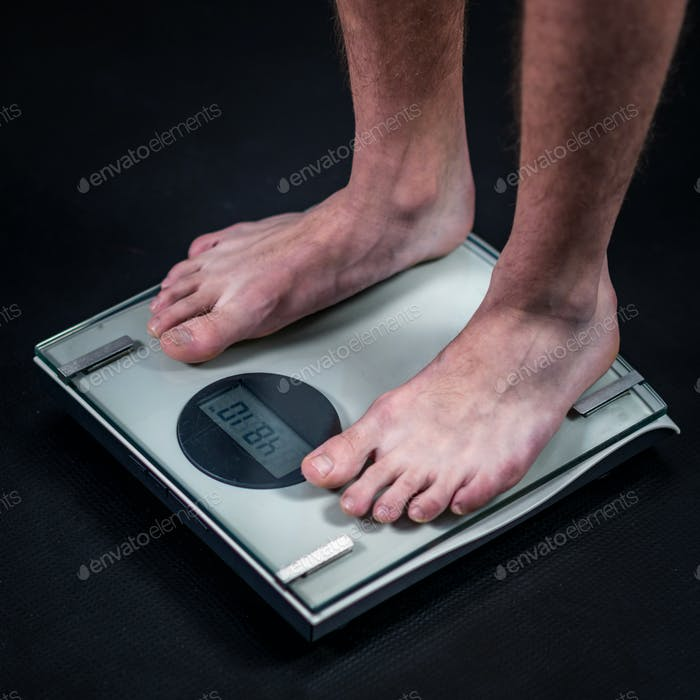 measuring weight of teenage boy