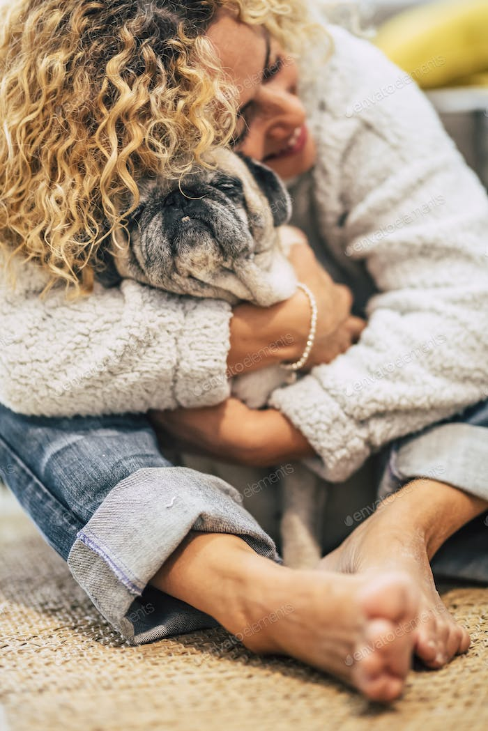 Best friends forever human and dog portrait with focus on pet and pretty woman