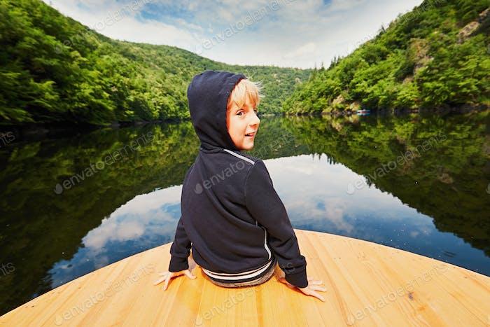 Little traveler on the boat