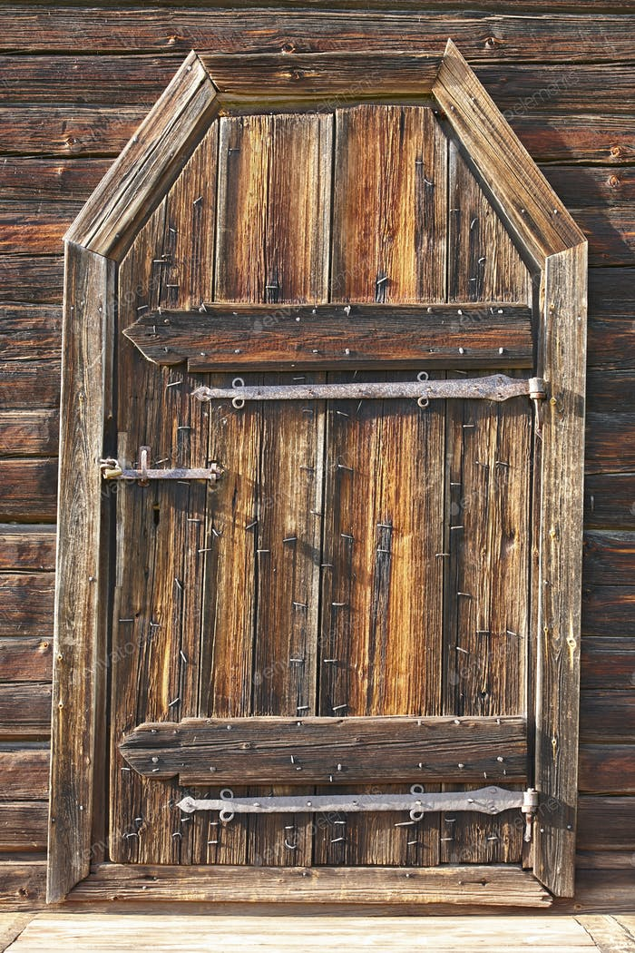 Antique rusted locked wooden door. Finland background heritage. Vertical