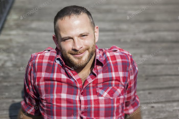 bearded handsome man relaxing outdoors in the sun