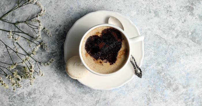Cup of coffee with heart made of foam