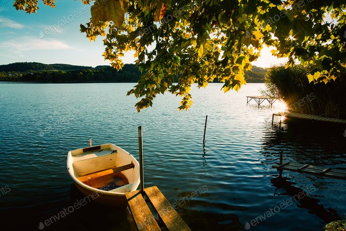 Peaceful atmosphere lake,boats and pier