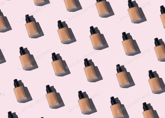 Make up foundation glass bottle pattern on pink