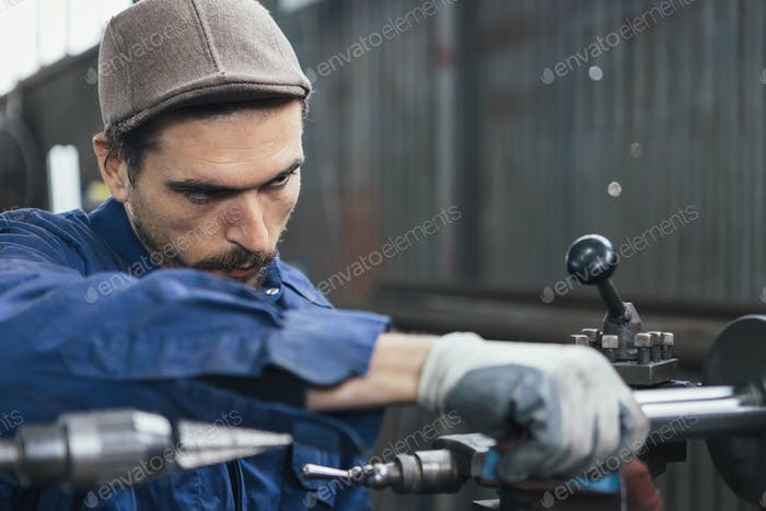 Close-up of man working with iron