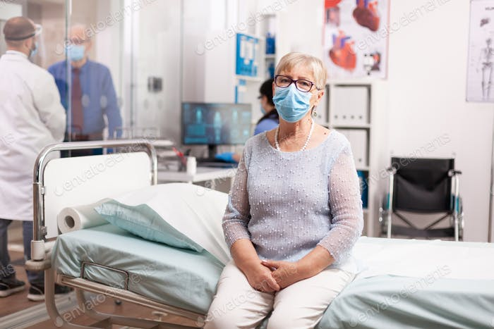 Senior woman waiting for doctor consultation in hospital