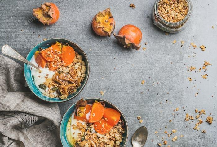 Healthy vegetarian breakfast in blue bowls, copy space