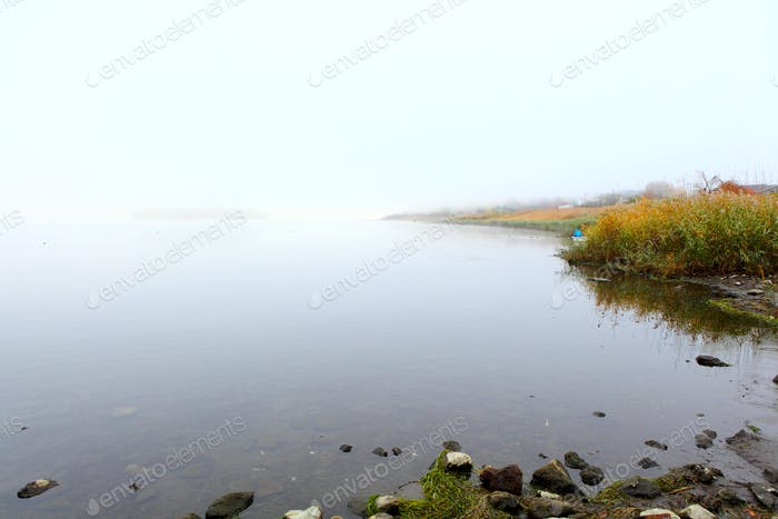 Lake with smog at morning