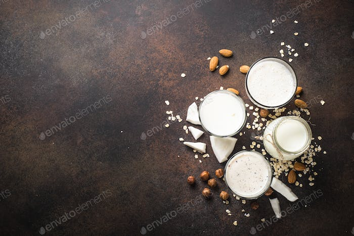 Vegan non dairy alternative milk, nuts and oat milk top view