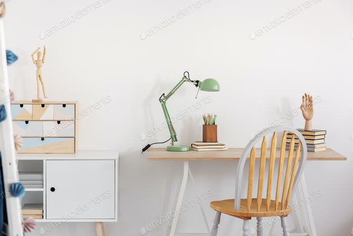 Wooden desk in white kid's bedroom