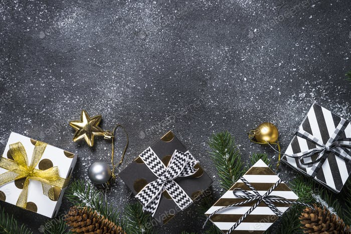 Christmas background - Gold and silver decorations and present b