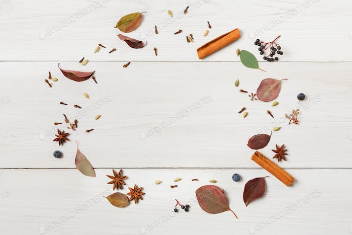 Autumn frame of dried flowers on white wood, Top view.
