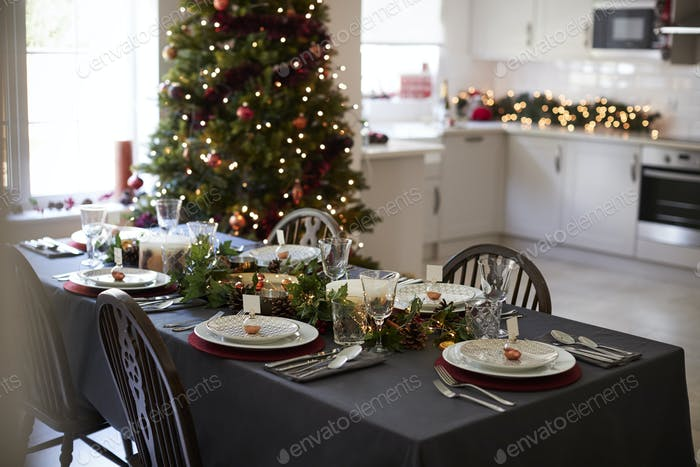Christmas table setting with bauble name card holders arranged on plates