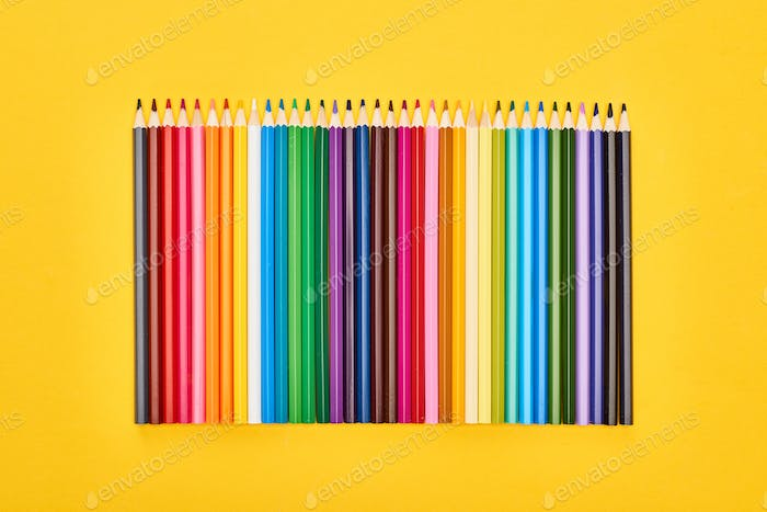 Panoramic Shot of Sharpened Color Pencils Isolated on Yellow