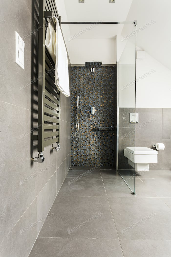 Grey bathroom with shiny tiles