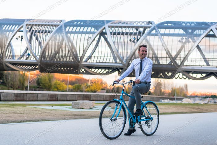 Business man riding a vintage bicycle in the city