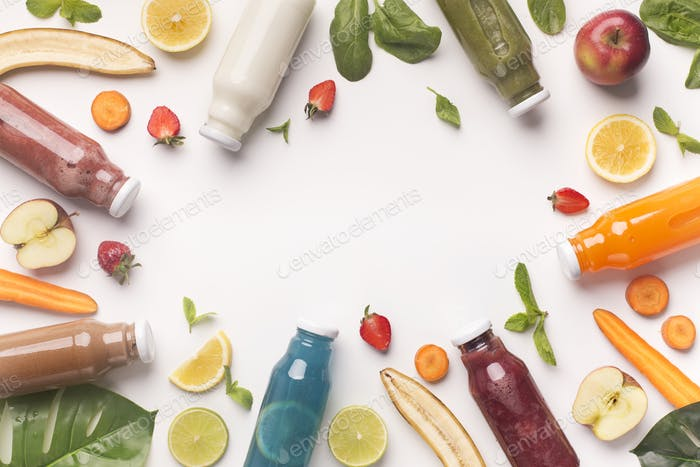Assorted flavoured smoothies and fresh ingredients on white