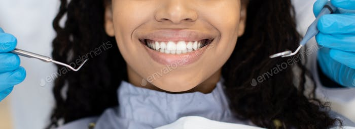 Smiling Black Female Patient Getting Treatment In Stomatologic Clinic, Closeup Shot