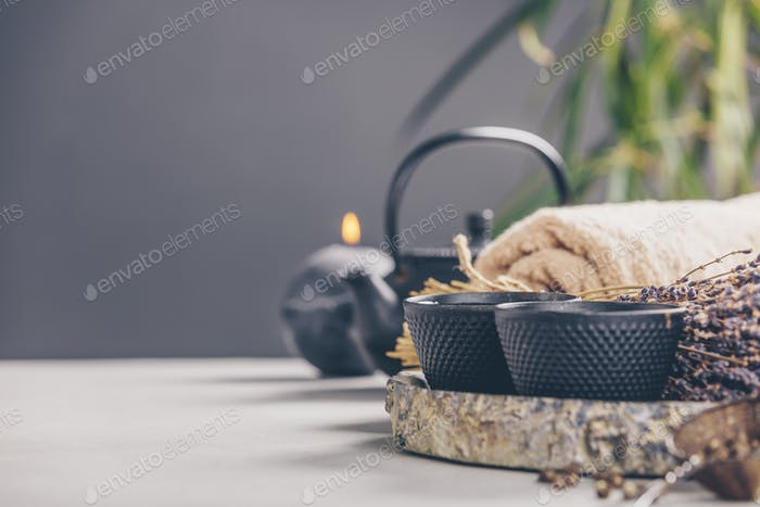 Tea and SPA composition on concrete background - space for text