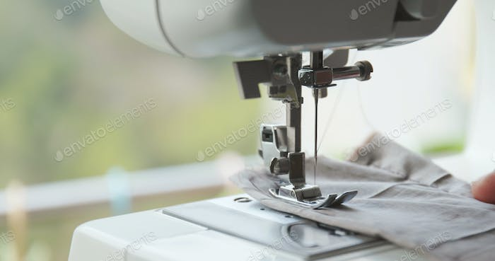Working part of sewing machine in action