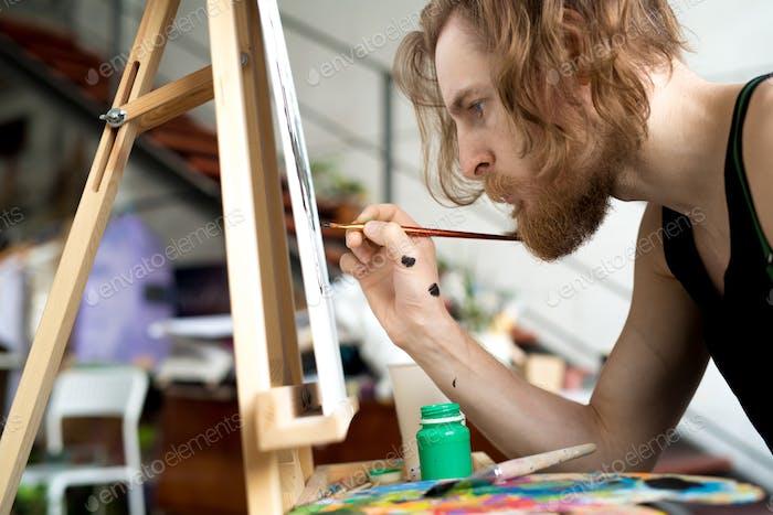 Bärtige Künstlermalerei Bild