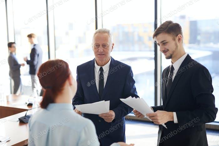 Senior Businessman Talking to Employees
