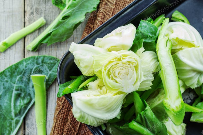 Cut the cabbage in a tray