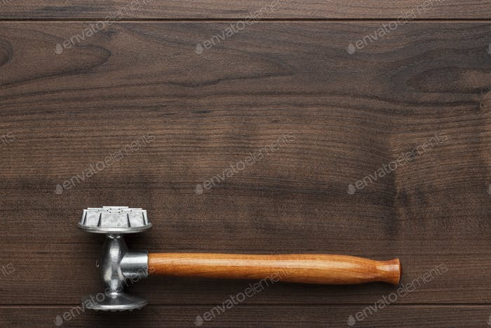 Kitchen Hammer On The Wooden Table