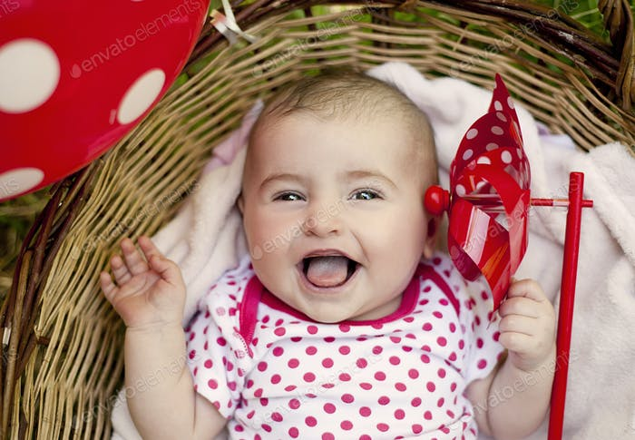 Cute baby girl in basket