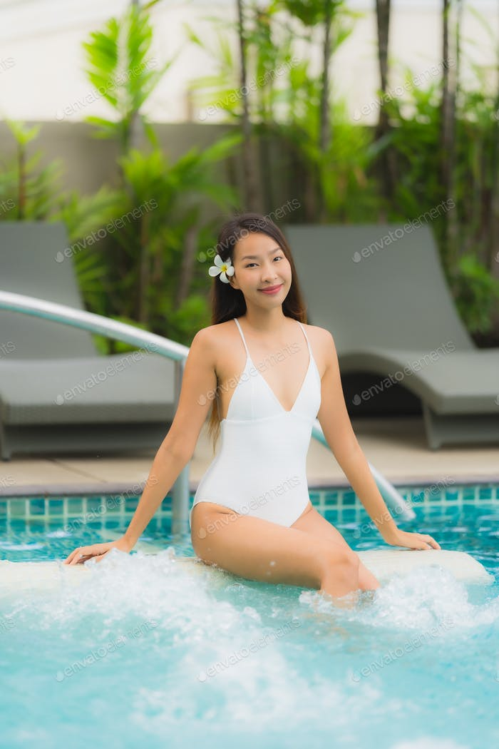 Portrait young asian woman happy smile relax around swimming poo