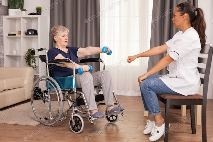 Rehabilitation for old woman in wheelchair