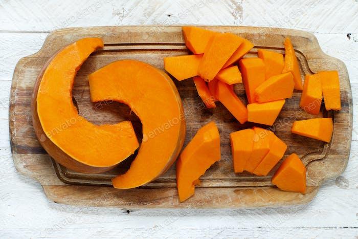Pumpkin slices on a wooden board