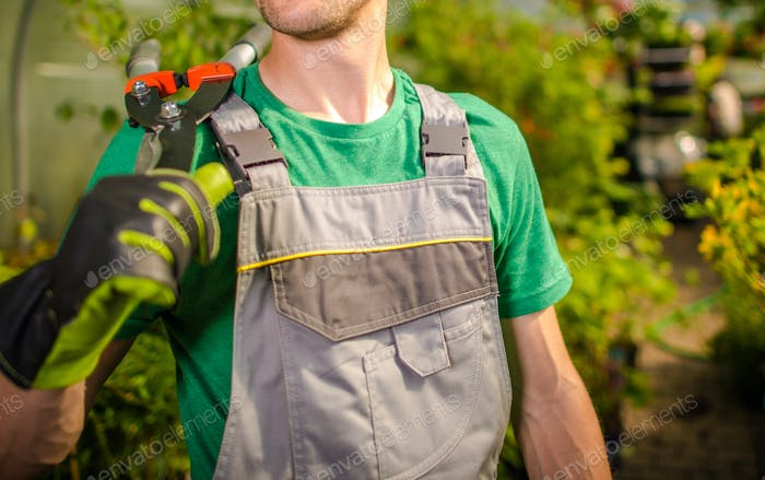 Gardener Keeping Scissors on His Shoulder