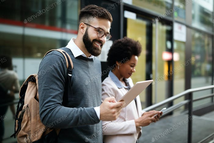 Couple, business, technology concept. Businessman with tablet and woman with smartphone talking