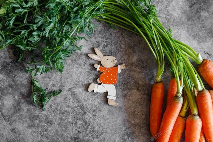 Fresh carrots in rustic style photo. Spring vegan food.