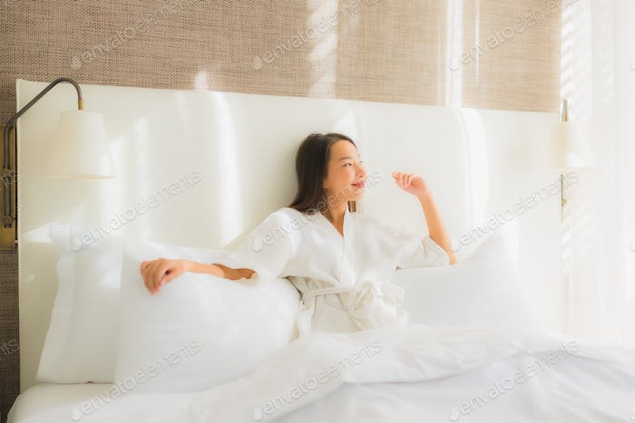 Portrait beautiful young asian woman relax smile on bed in bedroom