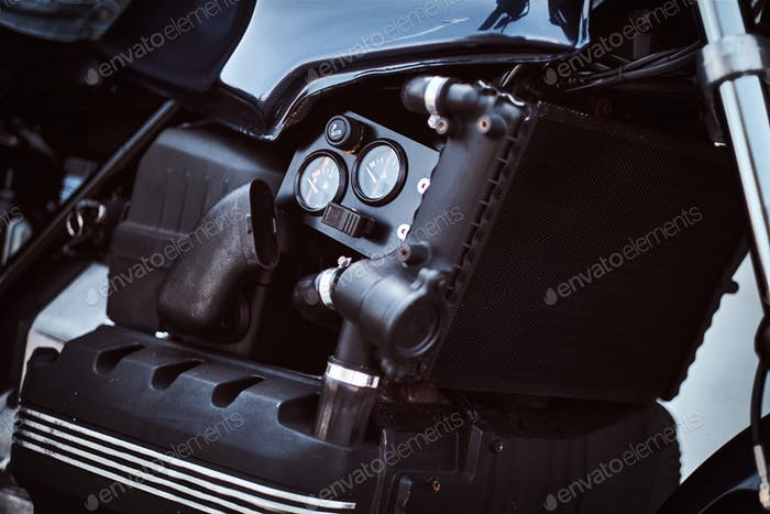 Close-up photo of a custom-made motorcycle fuel tank with sensors.
