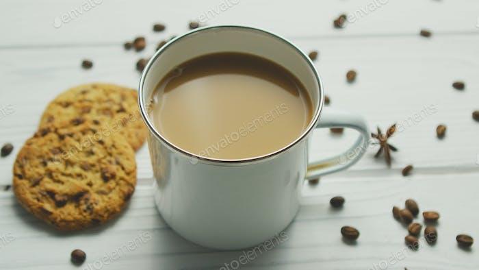 Mug with coffee and cookies