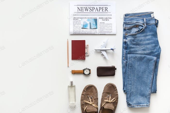 Casual male flat lay traveler clothes and accessories set isolated on white. Top view knolling