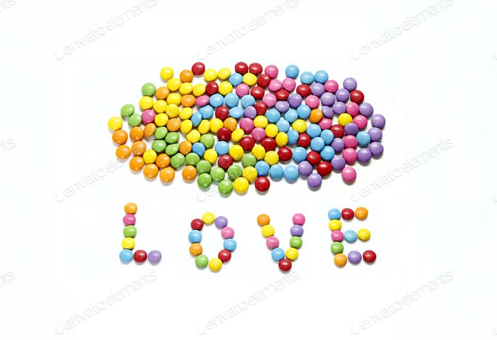 Word ''Love'' and bright colorful candy