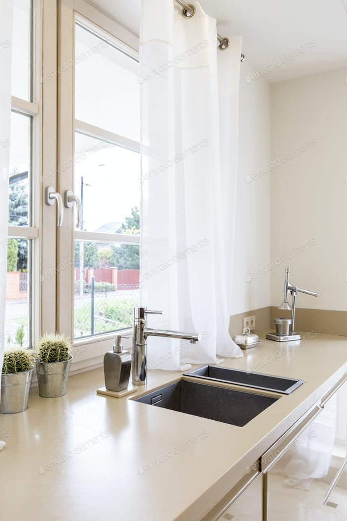 Kitchen worktop with amenities and sinks