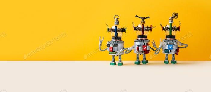 Three funny alien ufo robots, yellow wall background.