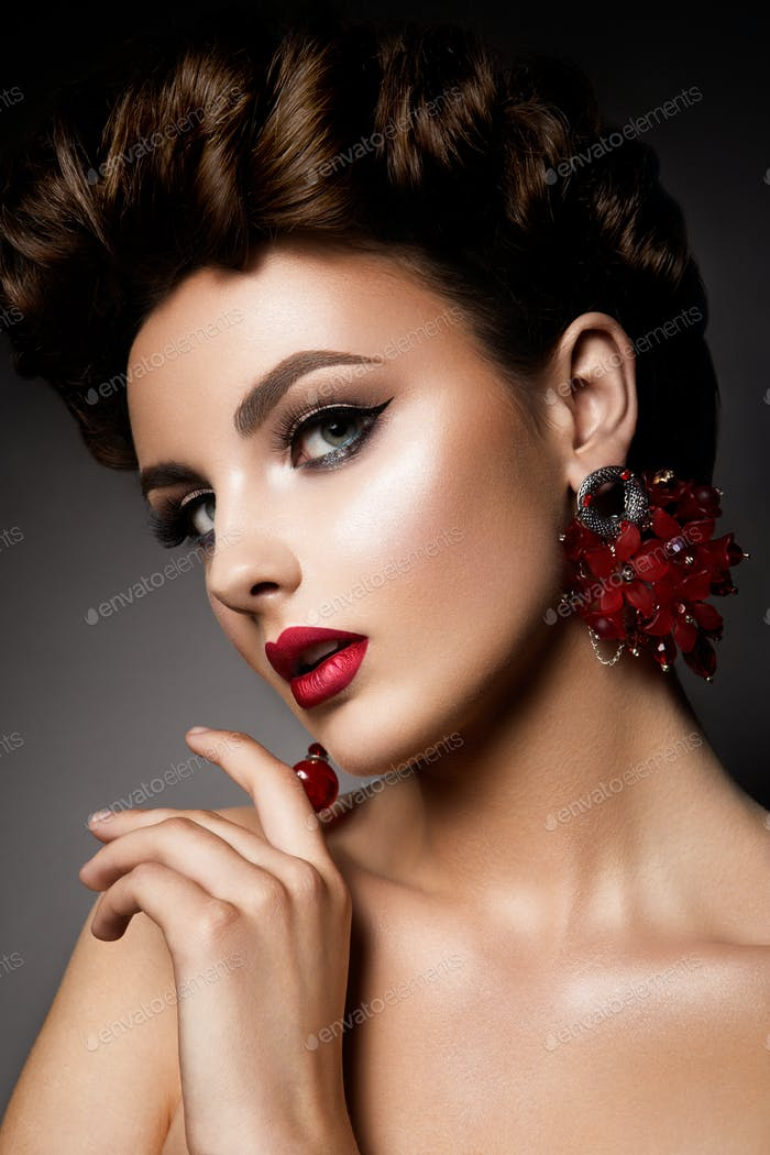 Beauty woman with blue eyes and red lips.
