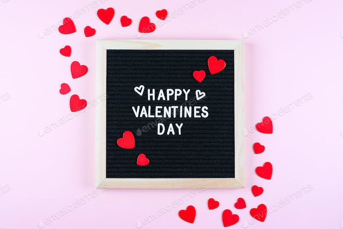Happy Valentines Day Card. Letters board with text. Pink background with festive decoration