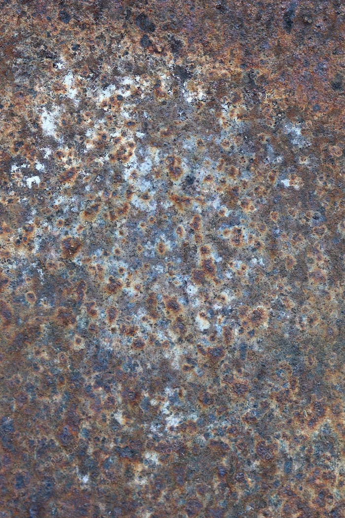 Rusty and worn surface of the iron plate