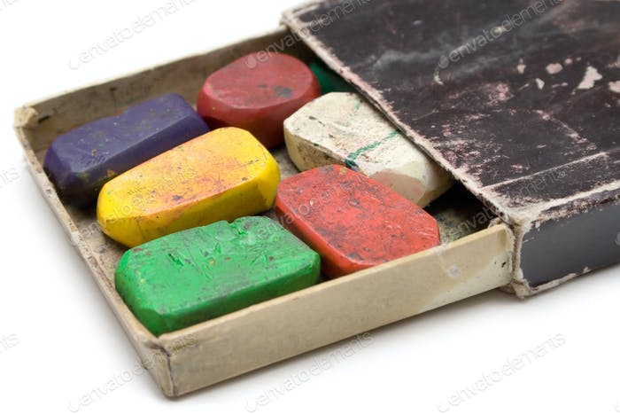 Grungy Box of Wax Crayons Isolated on a White Background