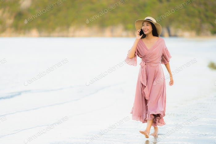 Portrait beautiful young asian woman smile happy walk with talki